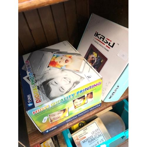 27 - A digital photo printer and a digital photo frame...