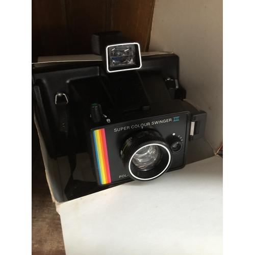 3 - A Polaroid Super Colour Swinger III land camera...