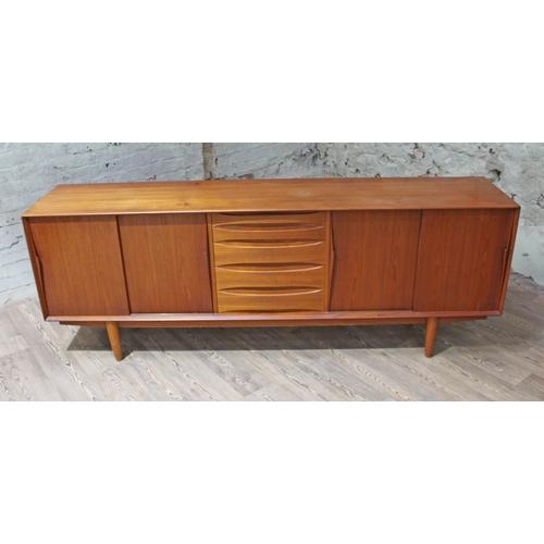 10 - A 1960s Danish teak sideboard in the manner of Arne Vodder, Dyrlund label to interior, length 220cm,...