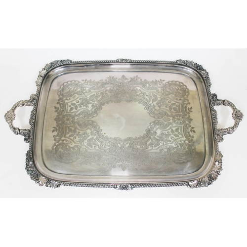 102 - An early Victorian silver plated tray by Walker & Hall, Sheffield 1844, with gadrooned shell and fol...