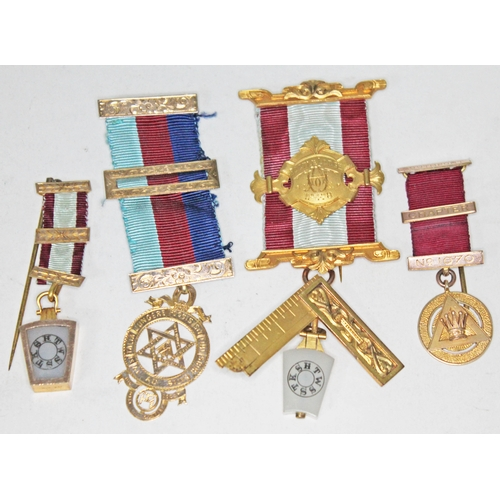 116 - A group of four hallmarked 9ct gold Masonic medals, gross weight 52.3g....