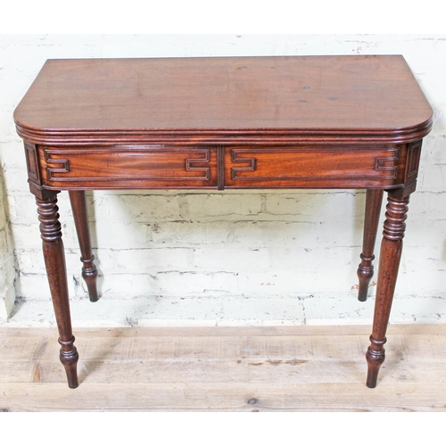 24 - A George IV mahogany fold over tea table in the manner of Gillows with geometric cock beading and tu...