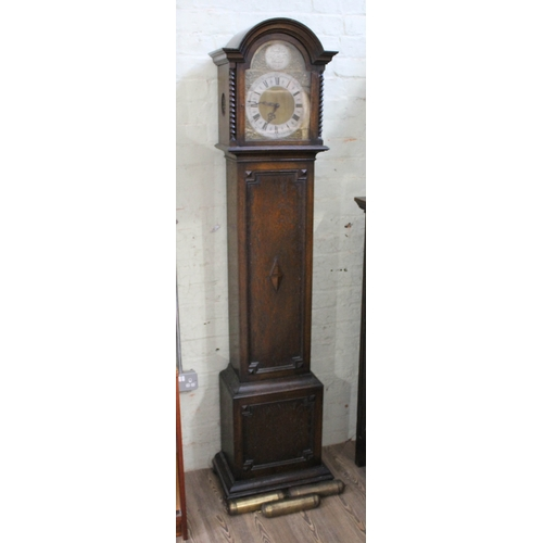 29 - A 1920s oak granddaughter clock, three weight driven West Minster chime movement, height 193cm....