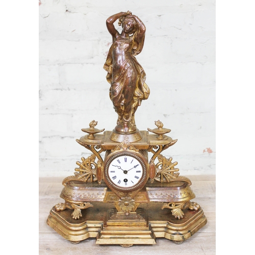 40 - A late 19th century French gilt metal figural mantle clock on wooden stand, height 52cm....
