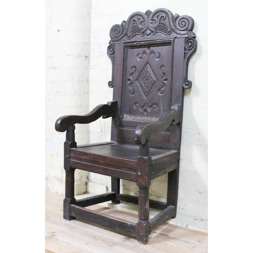 8 - A 17th century oak Wainscot armchair, width 57cm, depth 53cm & height 120cm....
