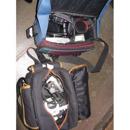 37 - 2 camera bags with cameras and accessories...