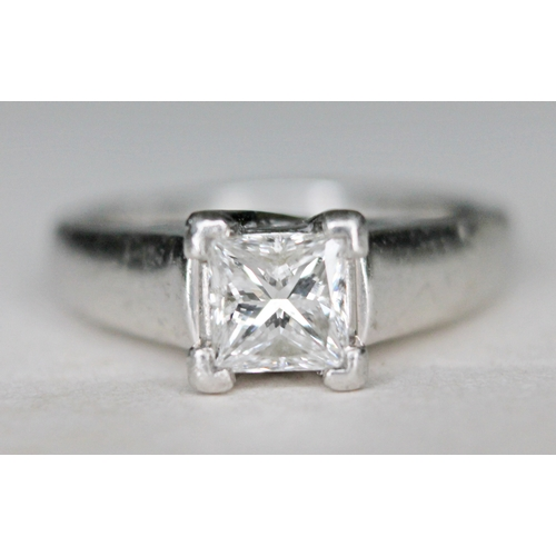 133 - A diamond solitaire ring, the princess cut stone approx. 0.78 carats, band with foreign platinum mar...