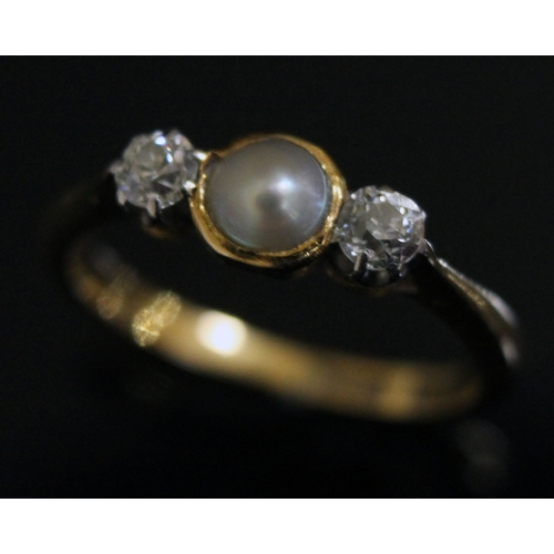 134 - A pearl and diamond ring, the band marked '18ct' size M, gross weight 2.8g....