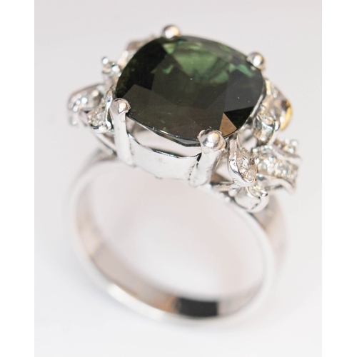 172 - A green tourmaline and diamond ring, the central stone approx. 7 carats, band marked '18K', gross we...