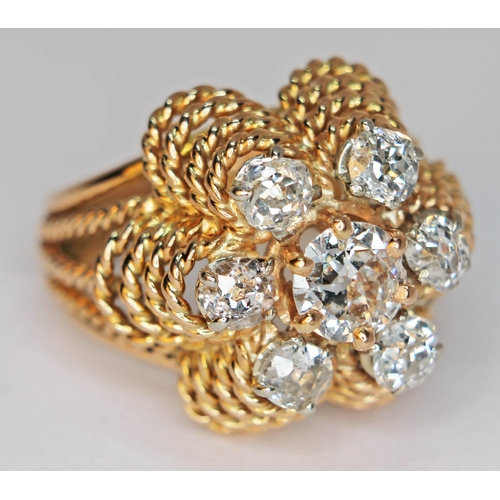 176 - A diamond cluster ring, the central stone approx. 0.50 carats, band unmarked, gross weight 8.1g, siz...