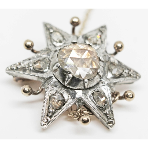222 - A 19th century diamond cluster star brooch featuring a central rose cut diamond, diameter approx. 7m...
