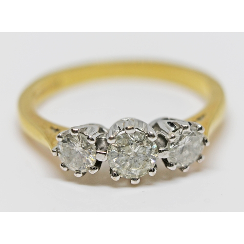 223 - A three stone diamond ring, total approx. diamond wt. 0.75 carats, hallmarked 18ct gold band, gross ...