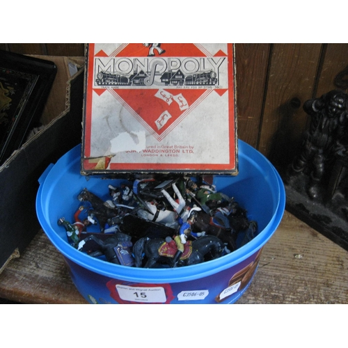 15 - A box of hand painted lead soldiers and an old Monopoly game...