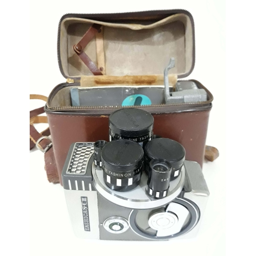 735 - A Yashica 8 EIII cine camera, cased with instructions and accessories....