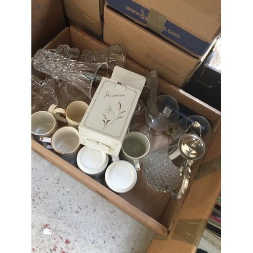 933 - A box containing mugs, decanter, jug, glassware, etc...