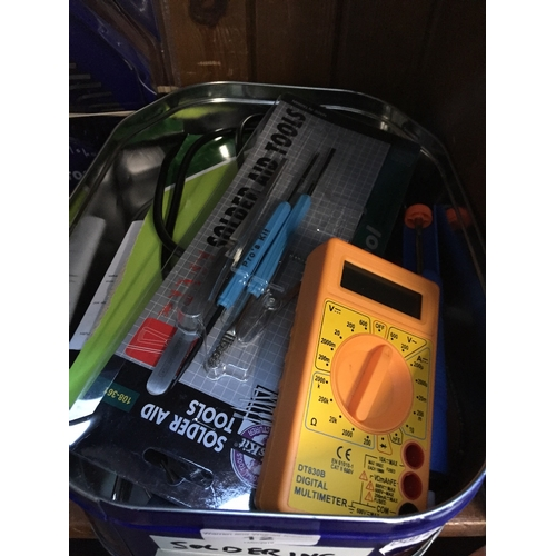 12 - A tin of soldering equipment...