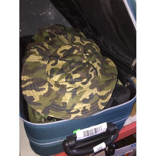 123 - A suitcase with army uniforms...
