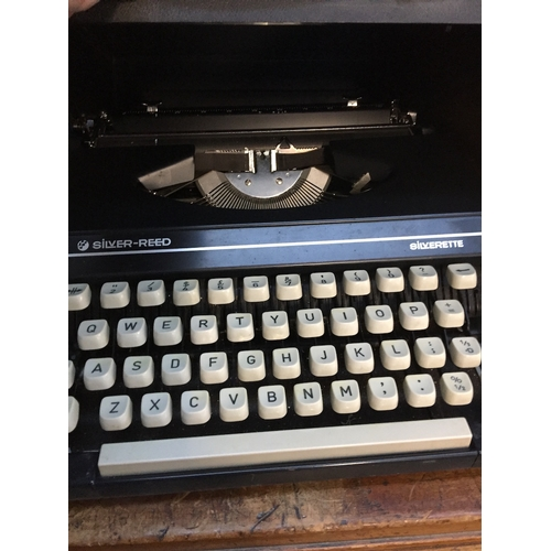 18 - A Silver Reed Silverette typewriter...