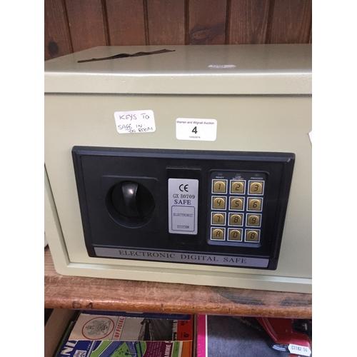 4 - A GX B0709 electronic digital safe with key...