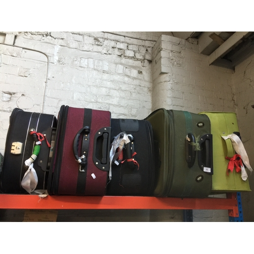 65 - 5 luggage suitcases on wheels...