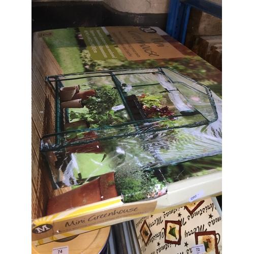 71 - A 2 tier mini greenhouse...