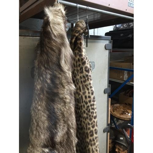 88 - A fur coat and a faux fur coat...