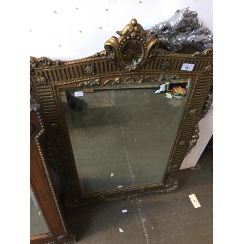 992 - Mirror in gilt frame...