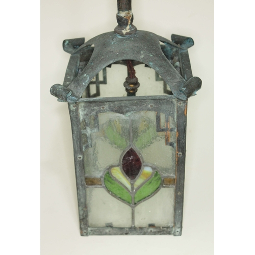 12 - An Arts & Crafts copper lantern hanging light with leaded glass panels, length (excluding fitting) 3...