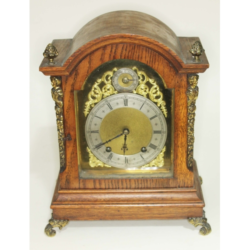 13 - A gilt brass mounted domed oak mantle clock, brass and steel dial with Roman numerals, height 33.5cm...