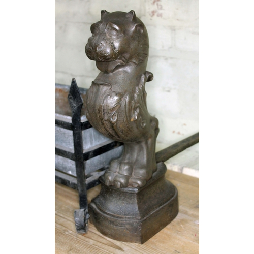 14 - A pair of 19th century cast iron fire dogs, each formed as mythical lion heads, acanthus body and si...