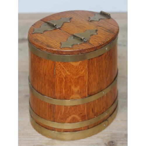 18 - A brass bound oak tobacco jar formed as a Royal Navy rum tub, circa 1900, height 16cm....