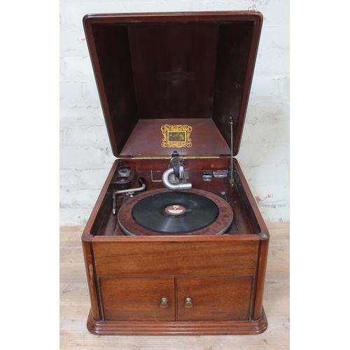 19 - A HMV mahogany cased table gramophone....