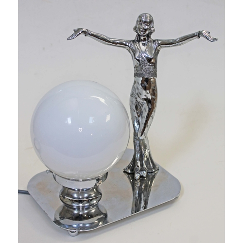 22 - An Art Deco lamp formed as a chrome plated dancing girl on silver plated base with glass globe shade...