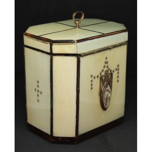 3 - A George III ivory and tortoiseshell strung tea caddy of octagonal form with gold loop handle to top...