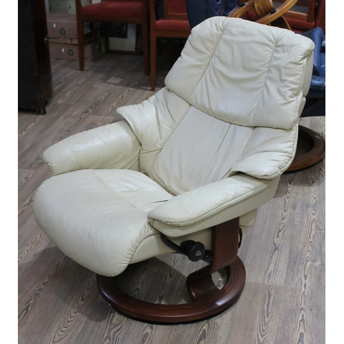 33 - A Norwegian Ekornes Stressless cream leather and laminate wood reclining armchair....