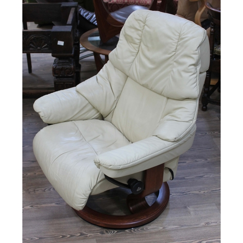 34 - A Norwegian Ekornes Stressless cream leather and laminate wood reclining armchair....