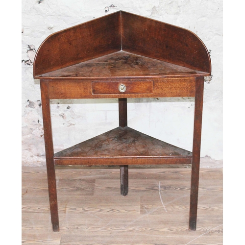 39 - A Georgian oak corner wash stand with single drawer and lower tier, height 98cm....