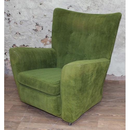 41 - A green upholstered armchair in the manner of Fritz Hansen, width 93cm, depth 93cm & height 94cm....