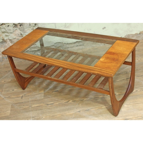 44 - A G-Plan teak coffee table with glass top and lower slatted tier, length 101cm....
