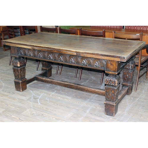 46 - A 17th century and later Continental oak draw leaf refectory table with carved frieze and carved squ...
