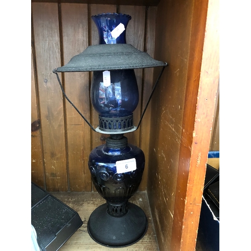 6 - A metal and cobalt glass lamp with shade...