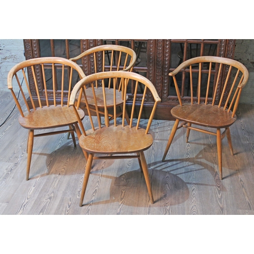10 - A set of four Ercol elm seated spindle back cow horn armchairs....