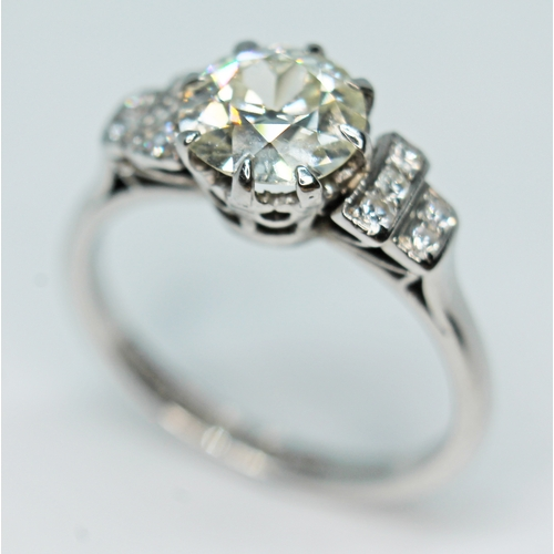 100 - A diamond solitaire ring by Boodle and Dunthorne, the central diamond approx. 1.40 carats, diamond s...