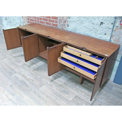 11 - A 1960s Danish style teak sideboard, length 228.5cm, depth 51cm & height 76cm....