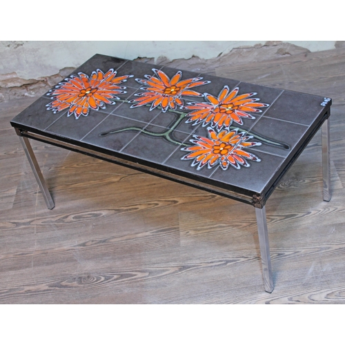 13 - A retro abstract tile top coffee table, length 93cm....