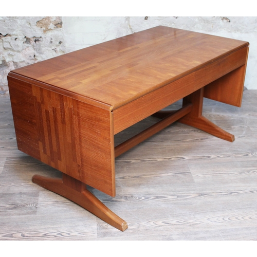 15 - A McIntosh parquetry inlaid teak coffee table with drop leaves, and two drawers, length 108cm....