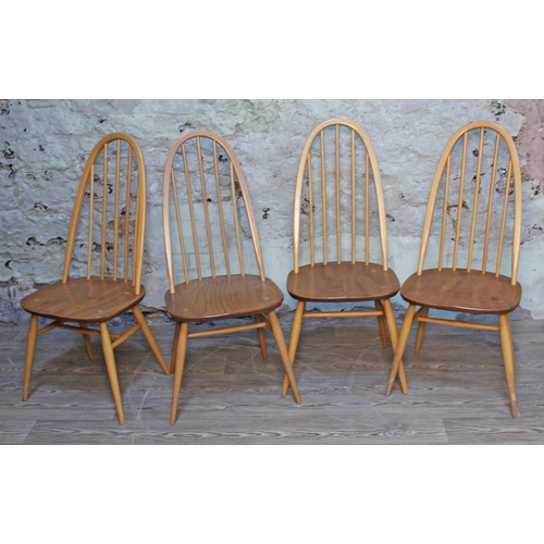 16 - A set of four Ercol blonde elm and beech spindle back chairs....
