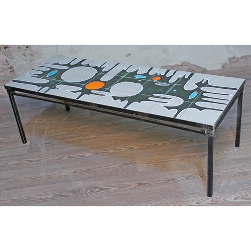 18 - A retro abstract tile top coffee table, length 122.5cm....