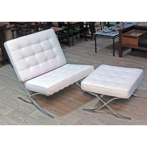 25 - A cream leather and polished steel Barcelona chair and matching stool after the original design by L...