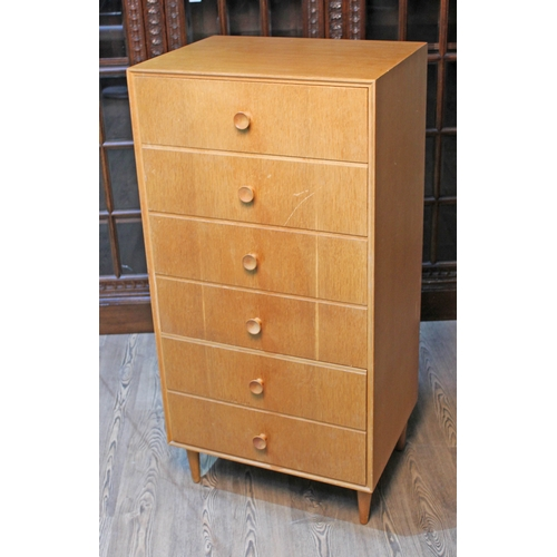 27 - A Meredew retro light oak narrow chest of drawers, width 61cm, depth 46cm & height 124cm....